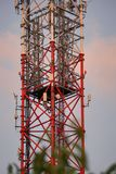 GSM and microwave atenna tower. Lattice telecommunication tower with microwave and GSM antennas at sunset stock photography