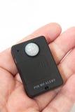 Gsm pir运动检测器在手上 免版税库存照片