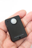Gsm pir motion detector in the hand.  Royalty Free Stock Photos