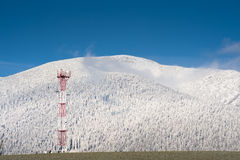 GSM tower in mountains Stock Photo