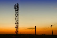 gsm tower and old telephone pylons Royalty Free Stock Image