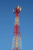 Gsm transmitter. Tower in front of a blue sky Royalty Free Stock Photo