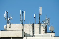 GSM transmitters on a roof. Of white administrative building. Close up Royalty Free Stock Images