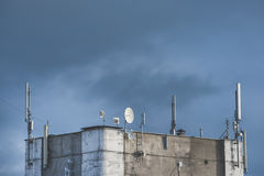 GSM transmitters on a roof of building Stock Images