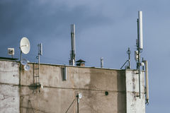 GSM transmitters on a roof of building Stock Photo