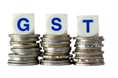 GST. Stacks of coins with the letters GST isolated on white background Stock Photo