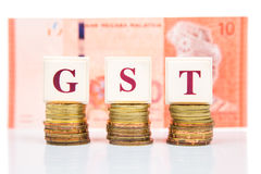 GST or Good and Services Tax concept with stack of coin and currency stock photos