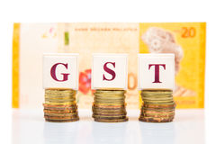 GST or Good and Services Tax concept with stack of coin and Malaysia Ringgit currency stock photography