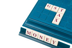 GST TAX concept with  crossword on  a board game Royalty Free Stock Images