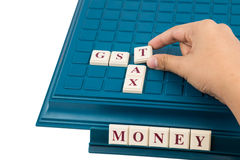 GST TAX concept with  crossword on  a board game Royalty Free Stock Photos