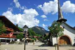 Gstaad. The main street of the exclusive swiss mountain resort of Gstaad with chapel Royalty Free Stock Image