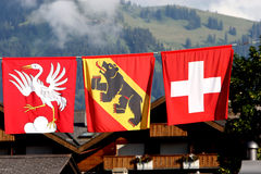 Gstaad: Flags. Flags of Switzerland (right) and the Canton of Bern (middle). Gstaad, Switzerland royalty free stock images