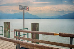 Gstadt Signpost at a pier in Chiemsee lake Stock Image