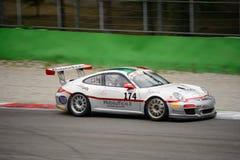 GT italiana ahueca Ebimototors Porsche 911 que compite con en Monza Foto de archivo