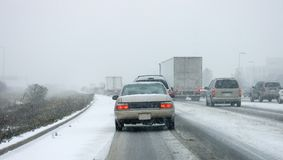 GTA First Snow Highway Mayhem. Rush hour bumper to bumper traffic on a highway during the winter's first snow Royalty Free Stock Image