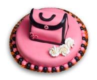 Gâteau d'anniversaire avec le givrage rose, sac à main décoré Photos stock