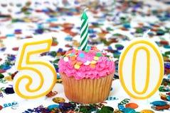 Gâteau de célébration avec la bougie - numéro 50 Image libre de droits