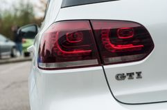 GTI sign on white Volkswagen Golf GTI rear parked in the street