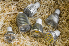 GU10 LED bulbs with different cooling on straw Royalty Free Stock Images