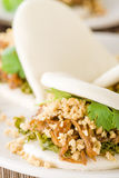 Gua Bao. Taiwanese sandwich of braised pork belly with pickled mustard greens, coriander and crushed peanuts in steamed buns Royalty Free Stock Images