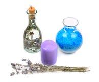Água de alfazema, sal e vela aromática Fotos de Stock Royalty Free