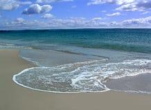 Água e areia Imagens de Stock