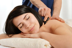 Gua sha acupuncture treatment. Woman receiving gua sha acupuncture treatment on back Stock Photography