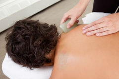 Gua Sha Treatment on Young Male royalty free stock images