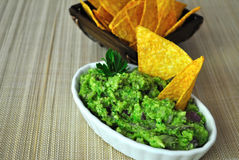 Guacamole. Healthy snack made from avocado, parsley, red onion, lemon juice, olive oil extra virgin with tortillas Royalty Free Stock Photo