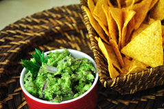 Guacamole. Healthy snack made from avocado, parsley, red onion, lemon juice, olive oil extra virgin with tortillas Stock Photos
