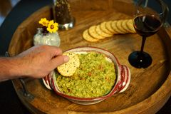 Guacamole appetizer is a party favorite stock images