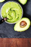 Guacamole. Avocado on a black background, top view image. Royalty Free Stock Photography