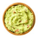 Guacamole, avocado dip, in wooden bowl Royalty Free Stock Photo