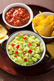 Guacamole with avocado, lime, chili and tortilla chips Royalty Free Stock Photo