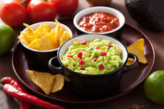 Guacamole with avocado, lime, chili and tortilla chips, salsa Royalty Free Stock Photography