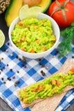 Guacamole with avocado, lime, tomato Stock Photography