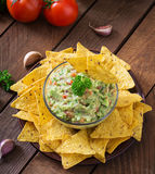Guacamole avocado, lime, tomato, onion and cilantro, served with nachos Stock Photo