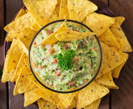 Guacamole avocado, lime, tomato, onion and cilantro, served with nachos Royalty Free Stock Photo