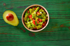Guacamole with avocado and tomatoes mexican Royalty Free Stock Images