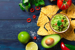 Guacamole bowl with ingredients Stock Photo