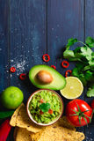 Guacamole bowl with ingredients Royalty Free Stock Images