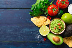 Guacamole bowl with ingredients Stock Photos