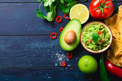 Guacamole bowl with ingredients Royalty Free Stock Photography
