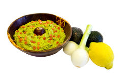 Guacamole. Bowl of guacamole and some vegetables isolated on white Stock Photography