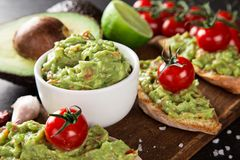 Guacamole with bread and avocado Royalty Free Stock Photo