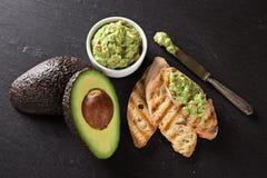Guacamole with bread and avocado Stock Photo