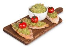 Guacamole with bread and avocado Stock Photos