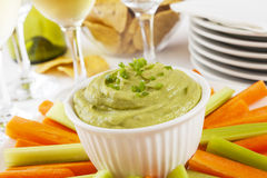 Guacamole with Carrot and Celery Sticks Stock Images