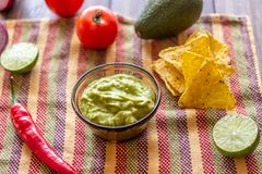 Guacamole and chips nachos in the colored napkin. Mexican cuisine stock images