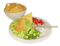 Guacamole and chips on white Stock Photo